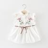 ชุดเดรสสีขาวปักลายดอกไม้ที่หน้าอก [size 1y]