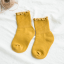 ถุงเท้าสั่น สีเหลือง แพ็ค 12คู่ ไซส์ L (อายุประมาณ 6-8 ปี) thumbnail 1