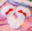 ถุงเท้าสั่ง สีขาวโบว์แดง แพ็ค 6 คู่ ไซส์ S (ประมาณ 1-3 ปี) thumbnail 1