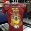 สกรีนลายเสือลงบนเสื้อยืดสีแดง ด้านหน้า thumbnail 1